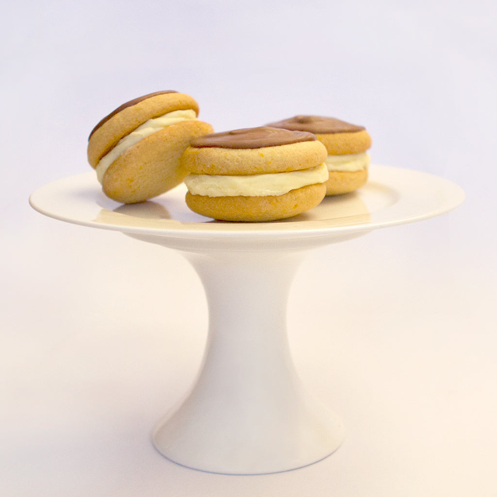 Orange and Chocolate Sandwich Biscuits on Stand