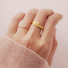 Load image into Gallery viewer, gold personalized ring in girl's hand