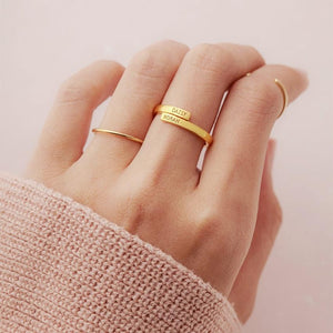 gold personalized ring in girl's hand