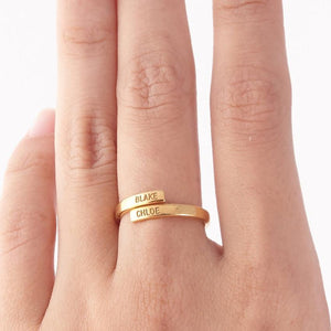 gold custom name ring in someone's hand
