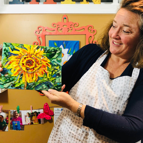 Mosaic Glass private class. Colors are yellows, oranges and greens of the sunflower. Each piece of glass is hand cut and adhered to the canvas using acrylic paint and Liquitex Heavy Gloss gel medium.