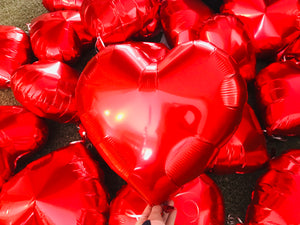 Add a red heart shaped helium balloon to your basket!