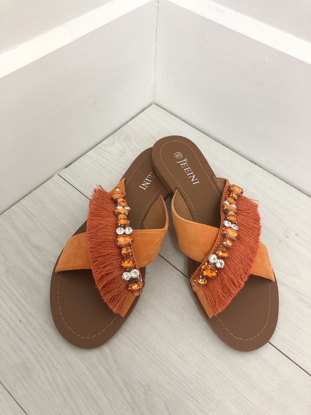 The Tropez Tassel Sandals in Orange
