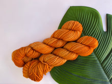 Load image into Gallery viewer, Delicious sock yarn 'Orange is the new black' colourway