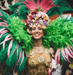 Lady dressed in large carnival costume