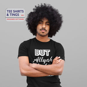Man with a huge Afro wearing a black organic cotton teeshirt with his arms folded across his chest looking vex. The teeshirt reads But Allyah Mecking Joke. 100% organic cotton