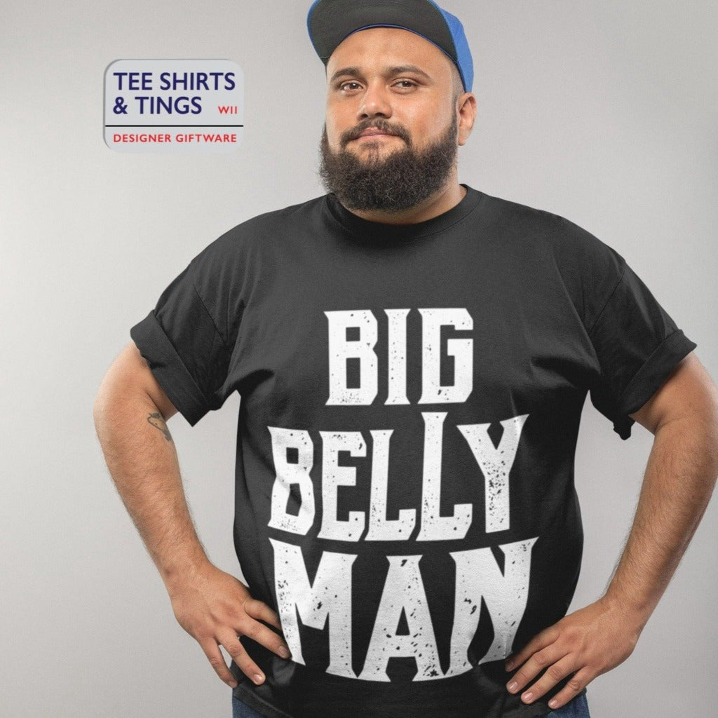 Man standing with hands on his hips. He is wearing a black teeshirt with the white wording saying Big Belly Man 100% organic cotton