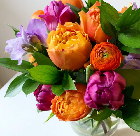 floral display with pinks, oranges and greenery