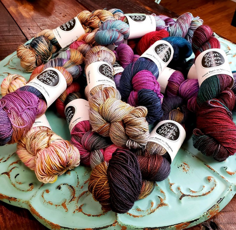 a collection of yarn on a table