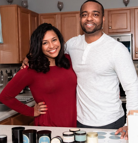Headshot of the owners in their kitchen with candle making materials in front of them