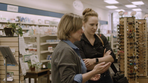 A pharmacist consults with a woman