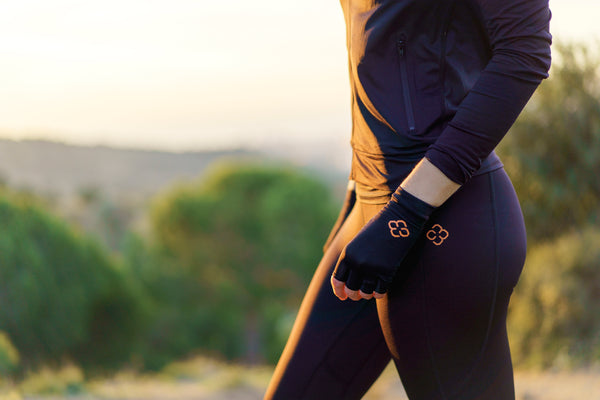 Copper Compression garments being worn during a hike on top of a tree filled hill