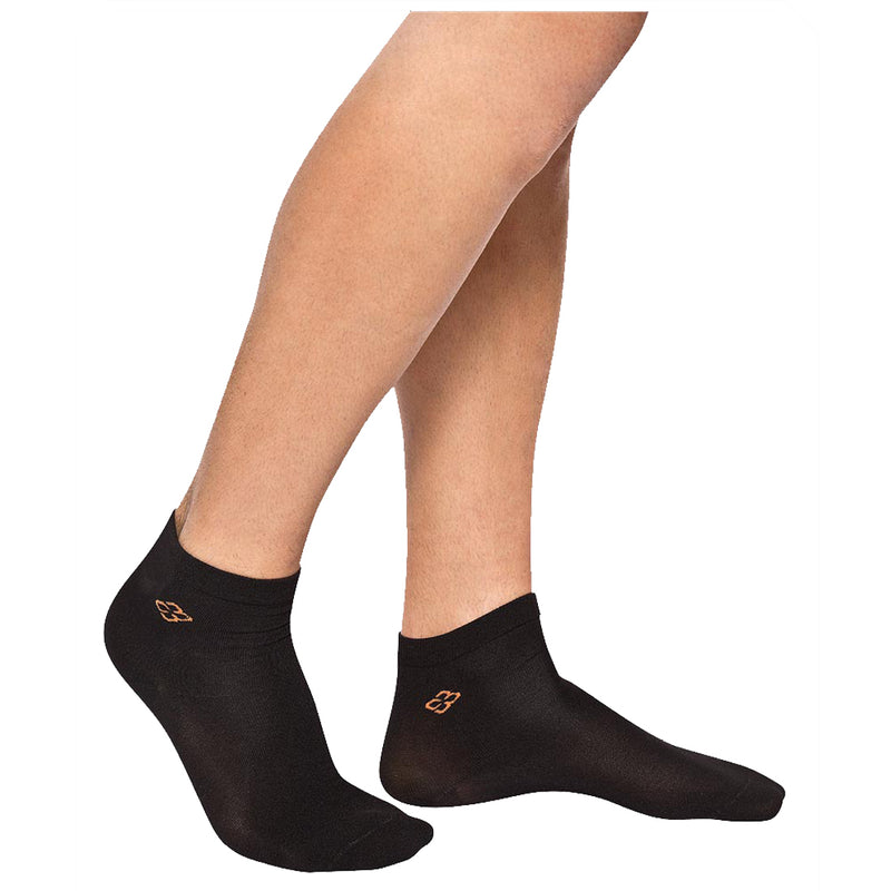 A person's legs from the knee down wearing Copper88 Compression ankle socks