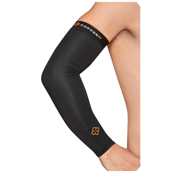 A person's hand rests on their hip while wearing a Copper88 compression arm sleeve