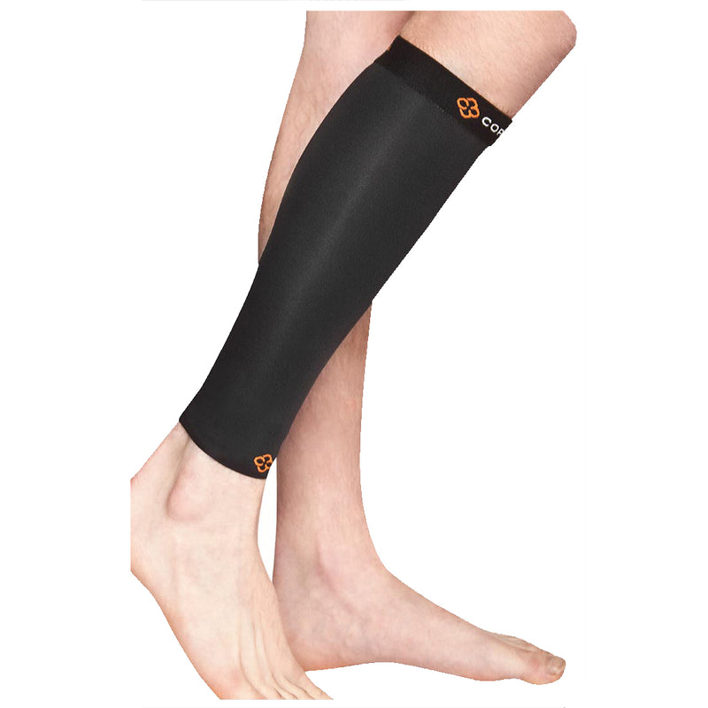 A person's legs from the knee down wearing black and grey compression calf sleeve in front of a white background