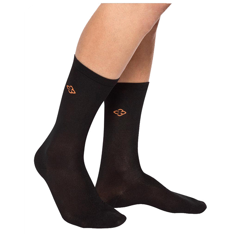 A pair of legs wearing black copper88 branded compression crew socks