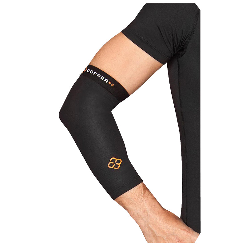 A person's hand rests on their hip while wearing a Copper88 compression elbow sleeve