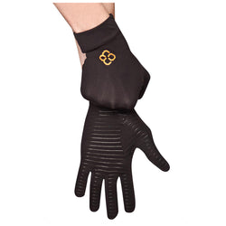 A pair of hands, one adjusting the black copper compression gloves on the other in front of a white background