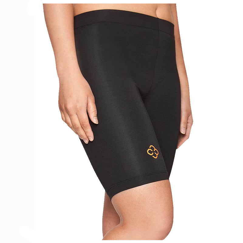 A ladie's arms are by her side as she wears black copper88 branded compression shorts in front of a white background