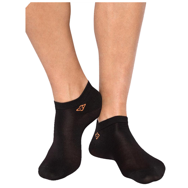 A person's feet wearing black copper88 ankle socks
