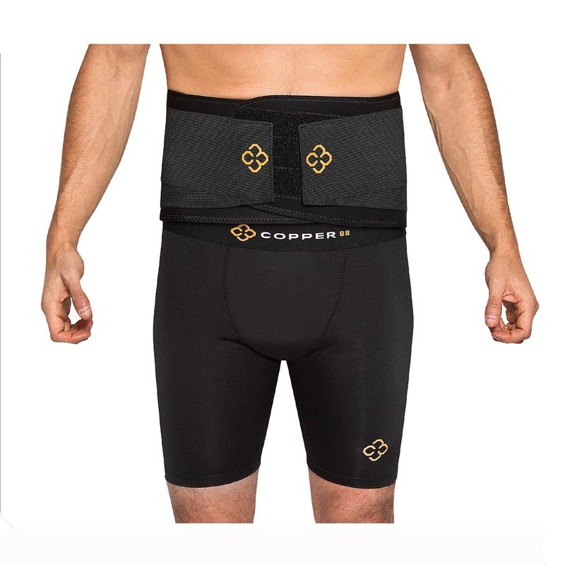A man in compression shorts wearing a back belt with Copper88 Logo