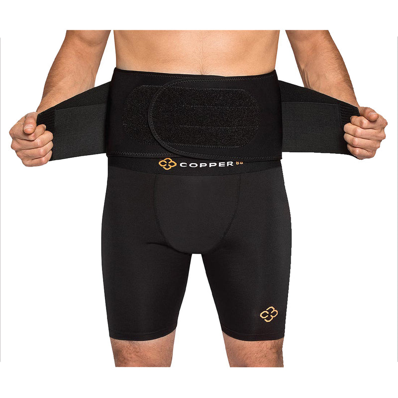A man wearing Copper88 clothing closing the straps of a compression belt around his hips