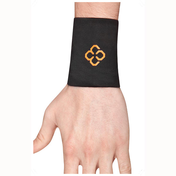A person's hand aimed downwards wearing a black copper 88 compression wrist sleeve in front of a white background