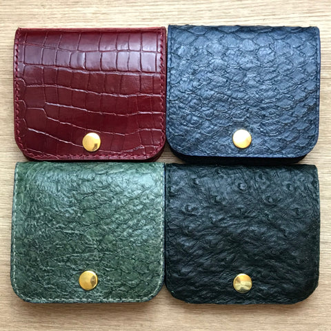 Coin tray cases here pictured in fish skin leather, croc print, and ostrich