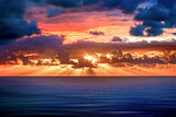Sun rays over the ocean at sunrise_Medium