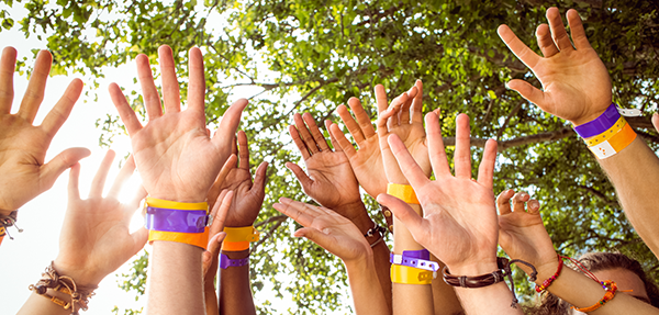 Hands up with wristbands