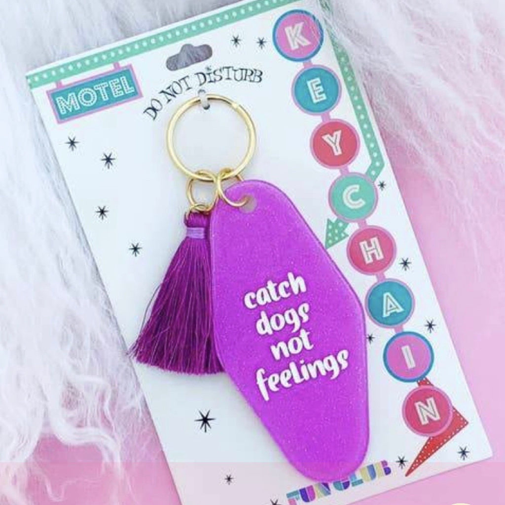 Catch dogs not feelings key chain