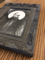 dark creepy art in frame