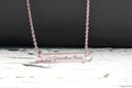 Inspirational horizontal heart cutout bar necklace by Pink Box