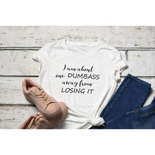 Fun Graphic Tee By Pink Box - ONE DUMBASS AWAY