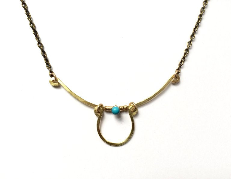 Necklace with hammered horseshoe and bar with crystal