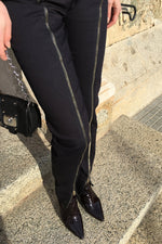 Slim fit trousers with zippers
