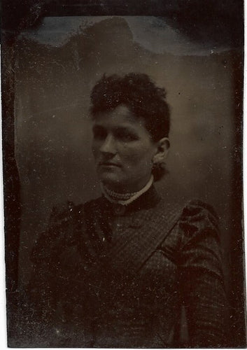 Tintype Photograph Portrait of a Woman with a Stoic Expression