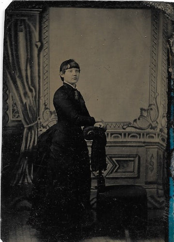 Tintype Photograph of a Woman Resting Her Hands on a Chair