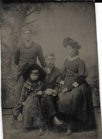 Tintype Photograph of Two Men, A Toung Woman, and a Child