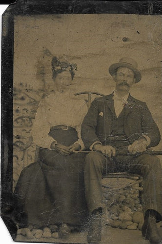 Tintype Photograph of a Seated Woman with a Man in a Hat with a Great Mustache