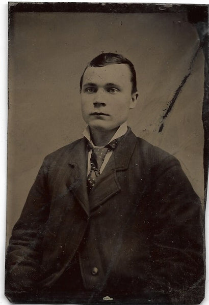 Tintype Photograph of a Solemn Looking Young Man