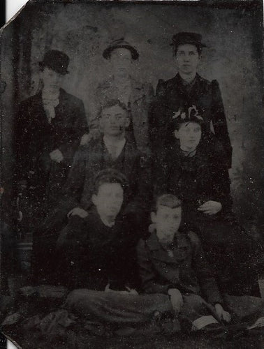 Tintype Photograph of a Group of Seven People in Three Rows