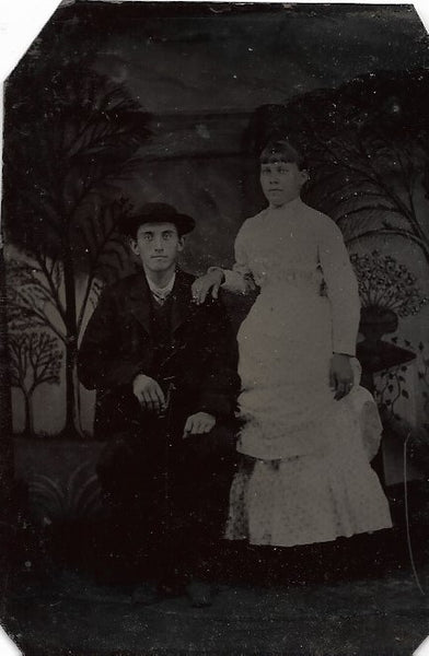 Tintype Photograph of a Man in a Hat Seated Beside a Woman in a White Dress