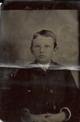 Tintype Photograph of a Young Boy with Parted Hair