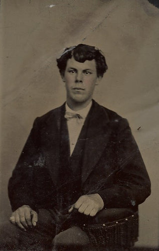 Tintype Photograph of a Seated Young Man with His Arm on an Armrest