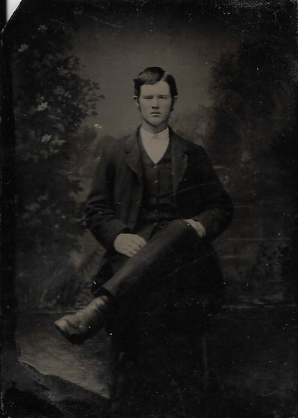 Tintype Photograph of a Man with a Comb-over and Crossed Legs