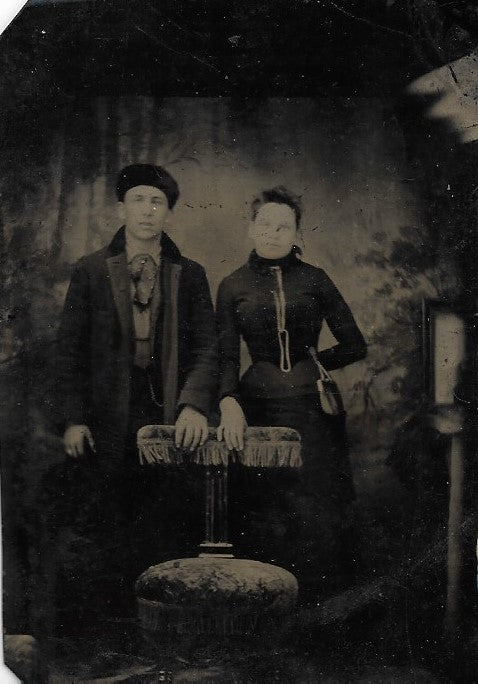 Tintype Photograph of a Couple with a Man in a Fur Hat
