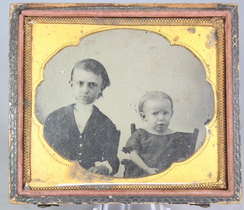 Ambrotype Photograph of Siblings with Concerned Expressions in Case