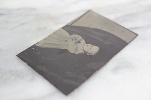 Postmortem Tintype Photograph of a Baby with Flowers in Repose