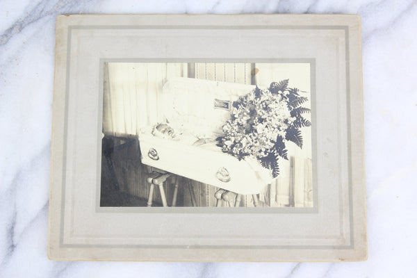 "Postmortem Matted Photograph of Young Child in Coffin, ""Our Darling"""